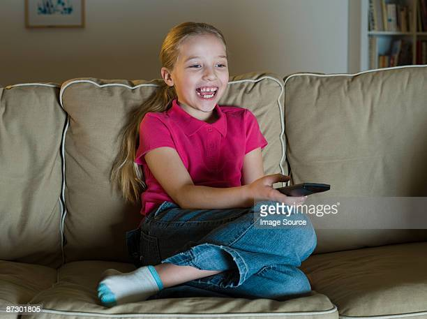 A girl watching tv