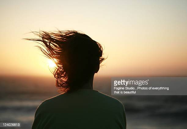 girl watching whale migration - windswept stock pictures, royalty-free photos & images