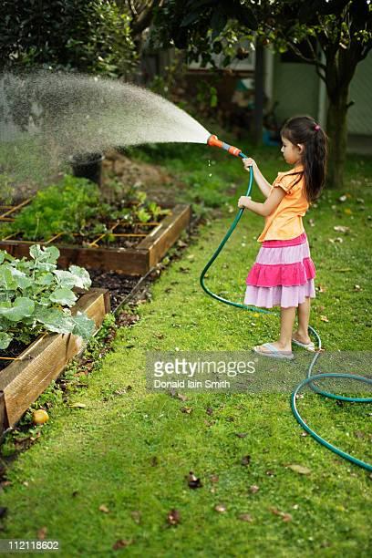 Girl waters garden