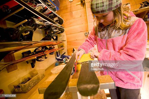 A girl waxes a pair of skies in Lake Tahoe, California.