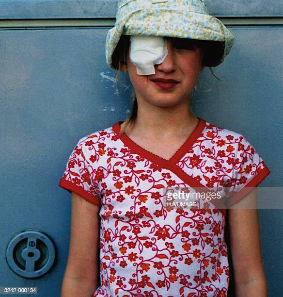 girl wearing a bandage - eye injury stock pictures, royalty-free photos & images