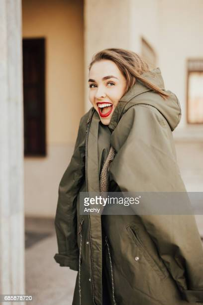 girl wearing a big coat - coat stock pictures, royalty-free photos & images