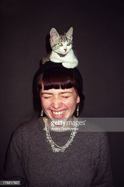 girl wearing a cat - domestic animals stock pictures, royalty-free photos & images