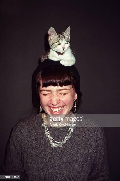 girl wearing a cat - gedomesticeerde dieren stockfoto's en -beelden