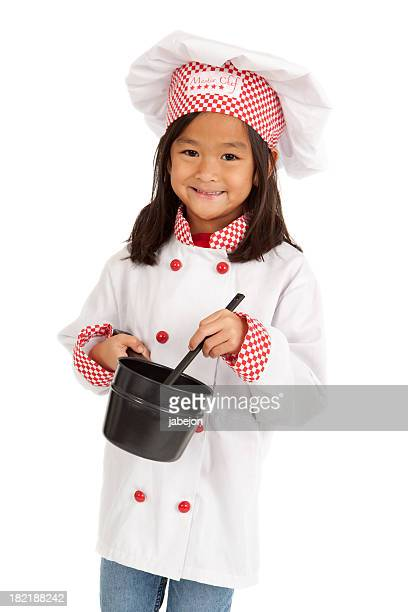 Girl wearing a chef costume against white background