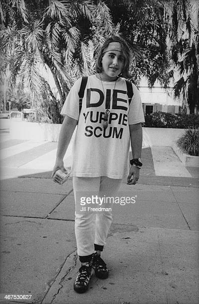 A girl wearing a 'Die Yuppie Scum' tshirt in Miami Beach Florida circa 1992