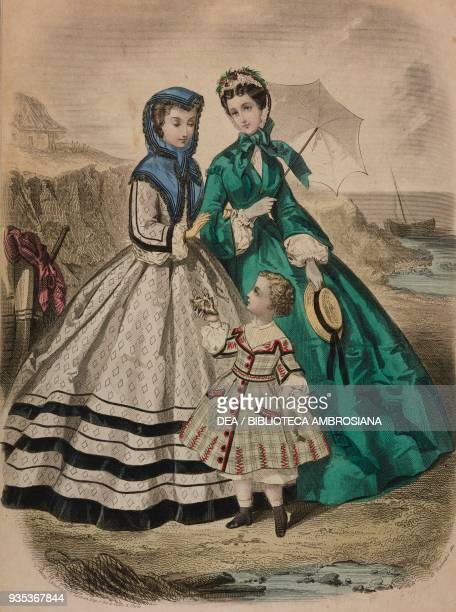 Girl wearing a dress with diamond design young woman wearing a taffeta dress and holding an umbrella threefour yearold boy wearing a pique dress...