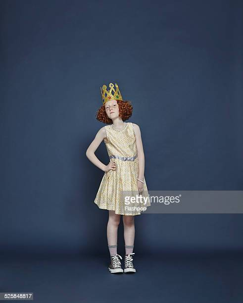 girl wearing a gold crown - crown stock pictures, royalty-free photos & images
