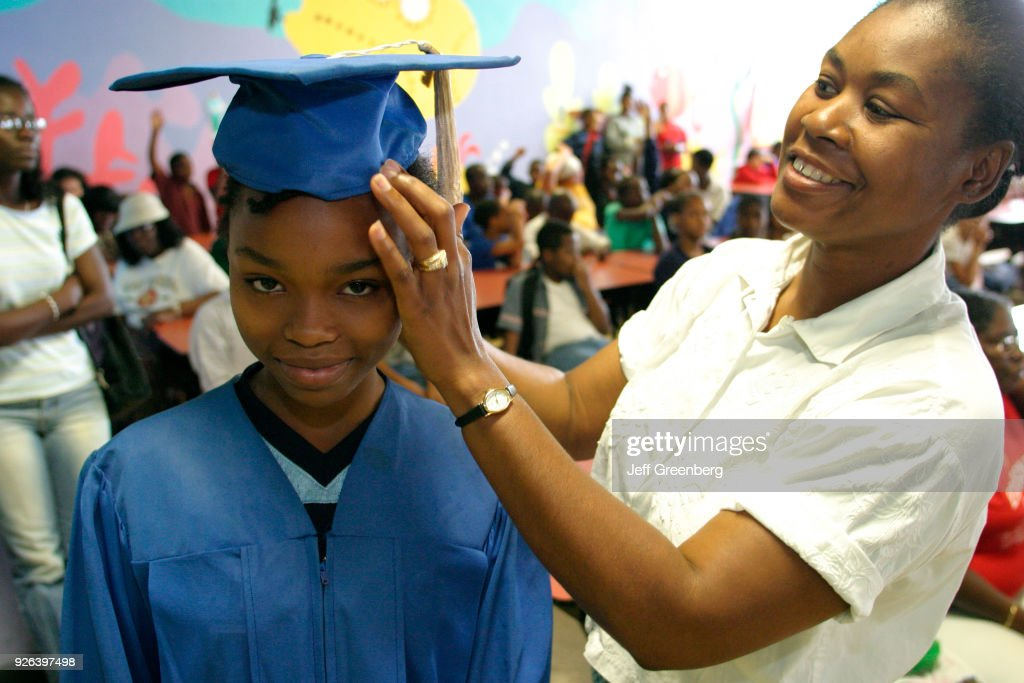 A girl wearing a graduation gown at Career Day held at Edison Park ...