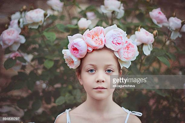 Girl wearing a headdress with roses