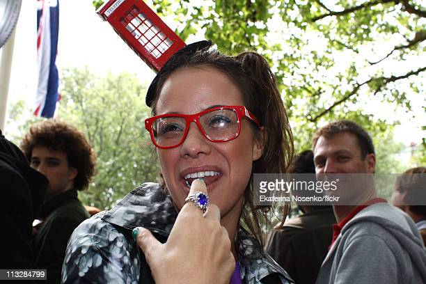 Girl wearing a phone box hat and a replica of Catherine's engagement ring poses on the Mall during the Royal Wedding of Prince William to Catherine...