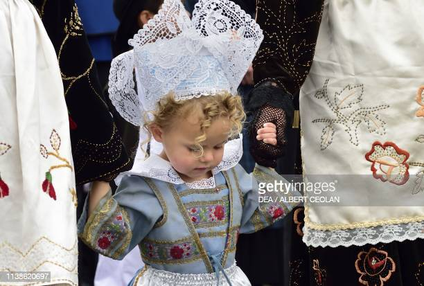 Girl wearing a traditional costume with lace headdress Festival of Blue Nets Concarneau Brittany France