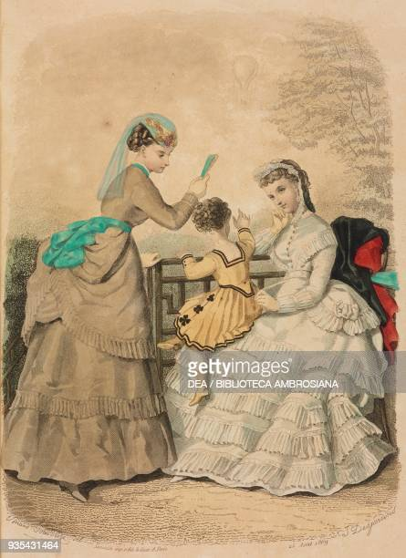 Girl wearing a travelling dress and holding a fan twothree yearold boy dress wearing a cloth nankeen outfit young woman wearing a city dress with a...