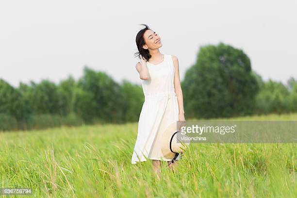 girl wearing a white dress - beautiful chinese girls stock photos and pictures