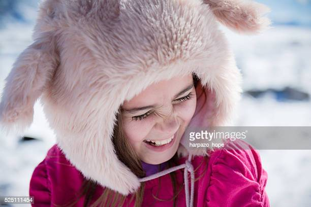 girl wearing a winter hat and laughing. - squinting stock photos and pictures