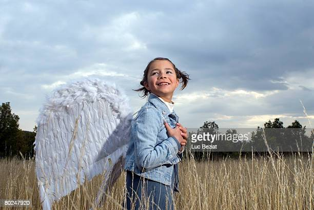 girl wearing angel wings. - earth angel stock pictures, royalty-free photos & images