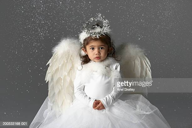 Girl (2-3) wearing angle costume, portrait