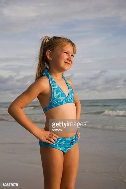 Girl wearing bikini at beach, Florida, United States