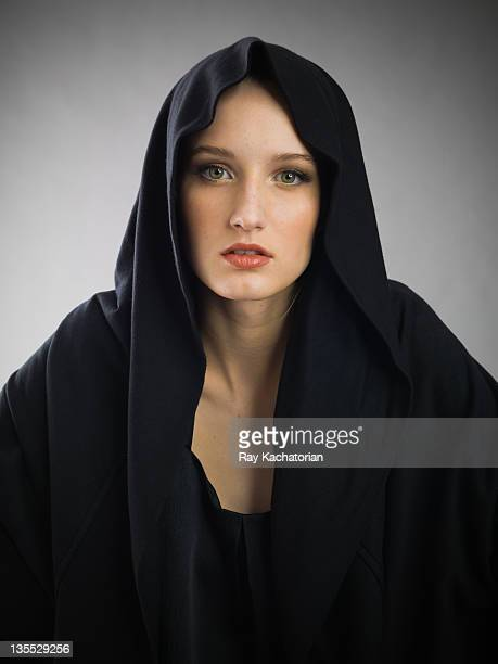 girl wearing black hoodie - black shirt stock pictures, royalty-free photos & images