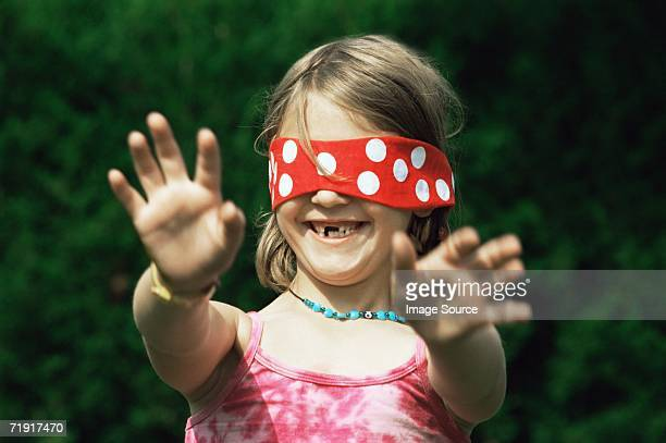 Girl wearing blindfold