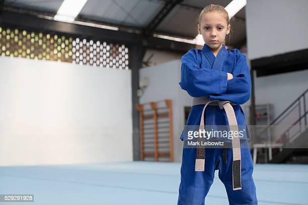 Girl (8-9) wearing blue gi