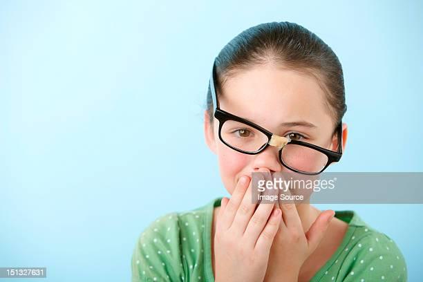 Girl wearing broken glasses