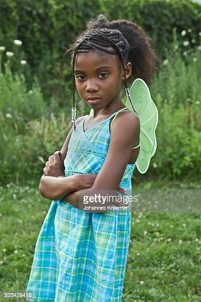 Girl wearing butterfly wings