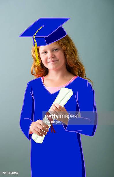 Girl wearing cartoon cap and gown