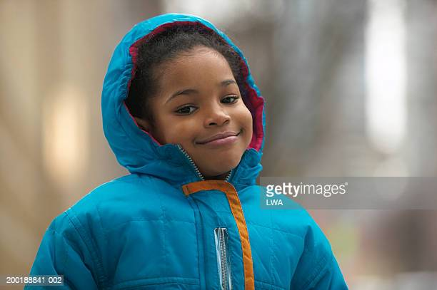 girl (6-9) wearing coat smiling, portrait - black coat stock pictures, royalty-free photos & images
