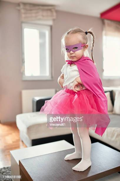 girl wearing costume of a superwoman - cape garment stock pictures, royalty-free photos & images