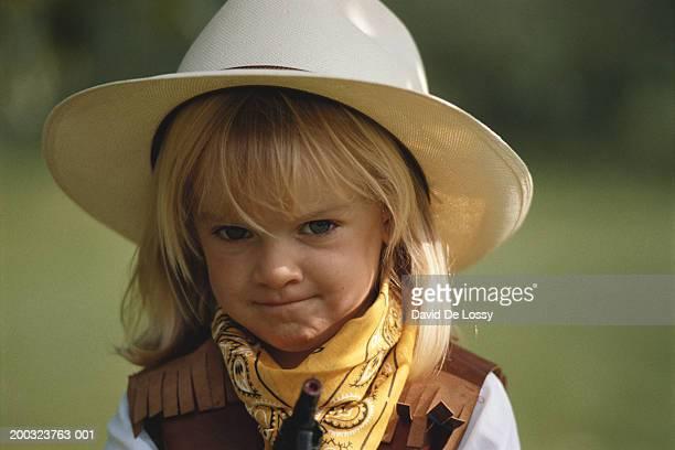 Girl (2-3) wearing cowboy costume, close-up
