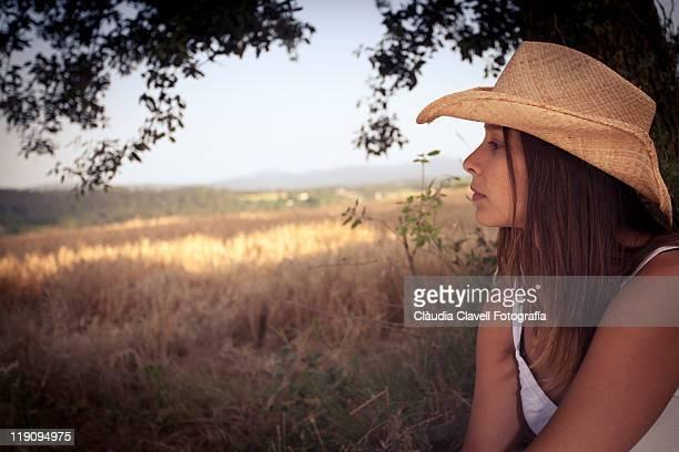 Girl wearing cowboy hat.