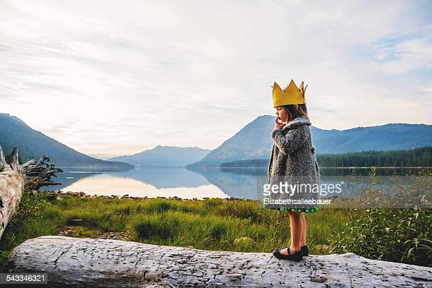 Girl (2-3) wearing crown outdoors