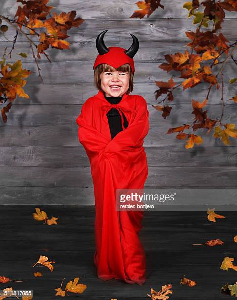 girl wearing devil costume, halloween - devil costume stock photos and pictures