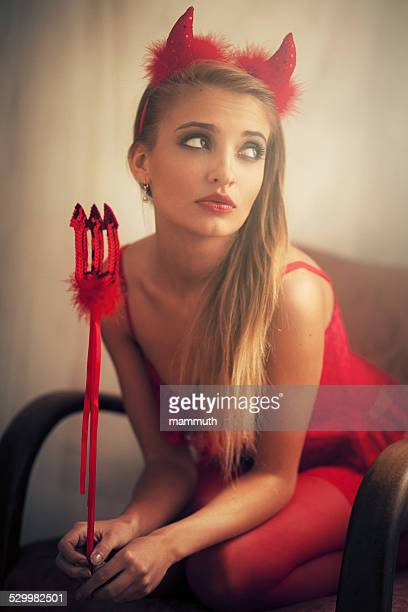 girl wearing devil dress - devil costume stock photos and pictures