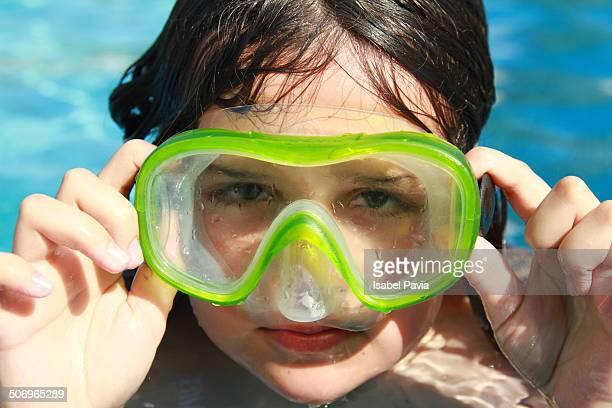 Girl wearing diving goggles in ocean