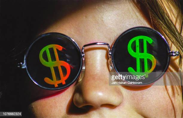 girl wearing dollaar sign sunglasses - capitalism stock pictures, royalty-free photos & images