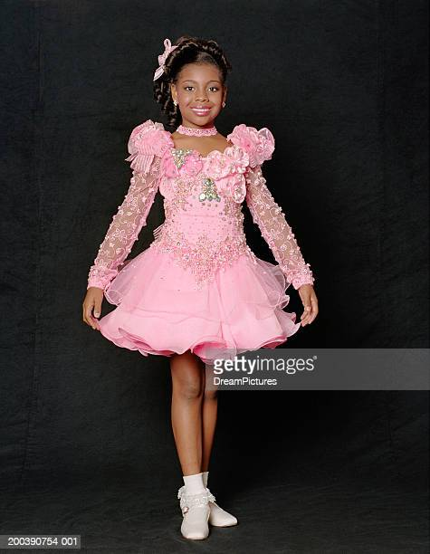 Girl (6-8) wearing dress for beauty pageant