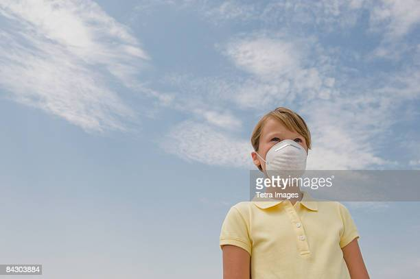 Girl wearing dust mask