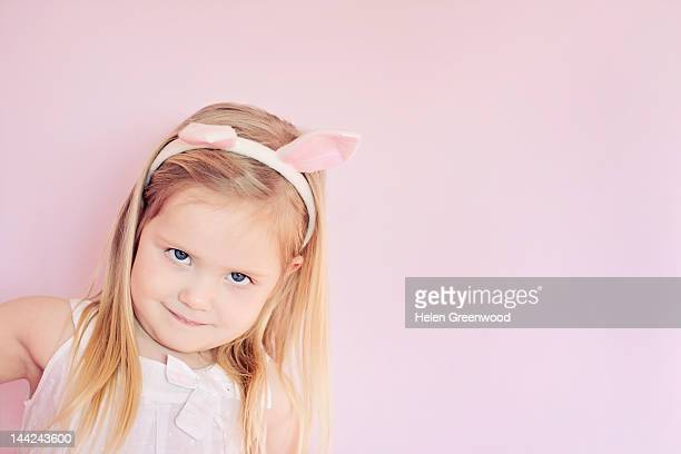 Girl wearing Easter rabbit ears