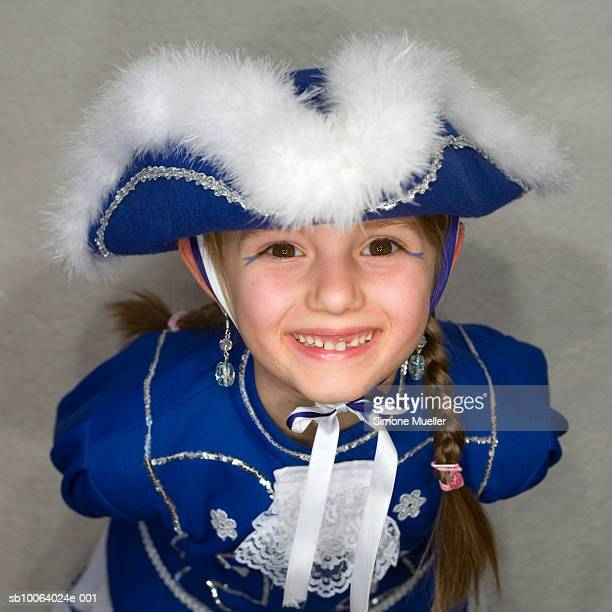 girl (6-7) wearing fancy costume, smiling, close-up, portrait - simone bent stock pictures, royalty-free photos & images
