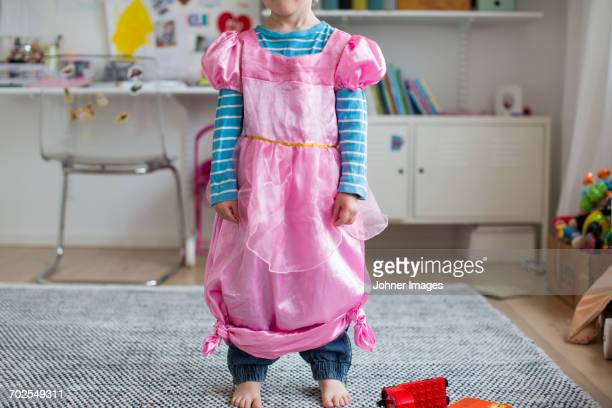 girl wearing fancy pink dress - prinzessin stock-fotos und bilder