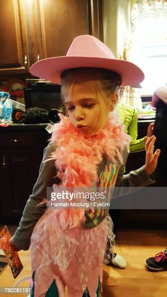Girl Wearing Feather Boa While Dancing At Home