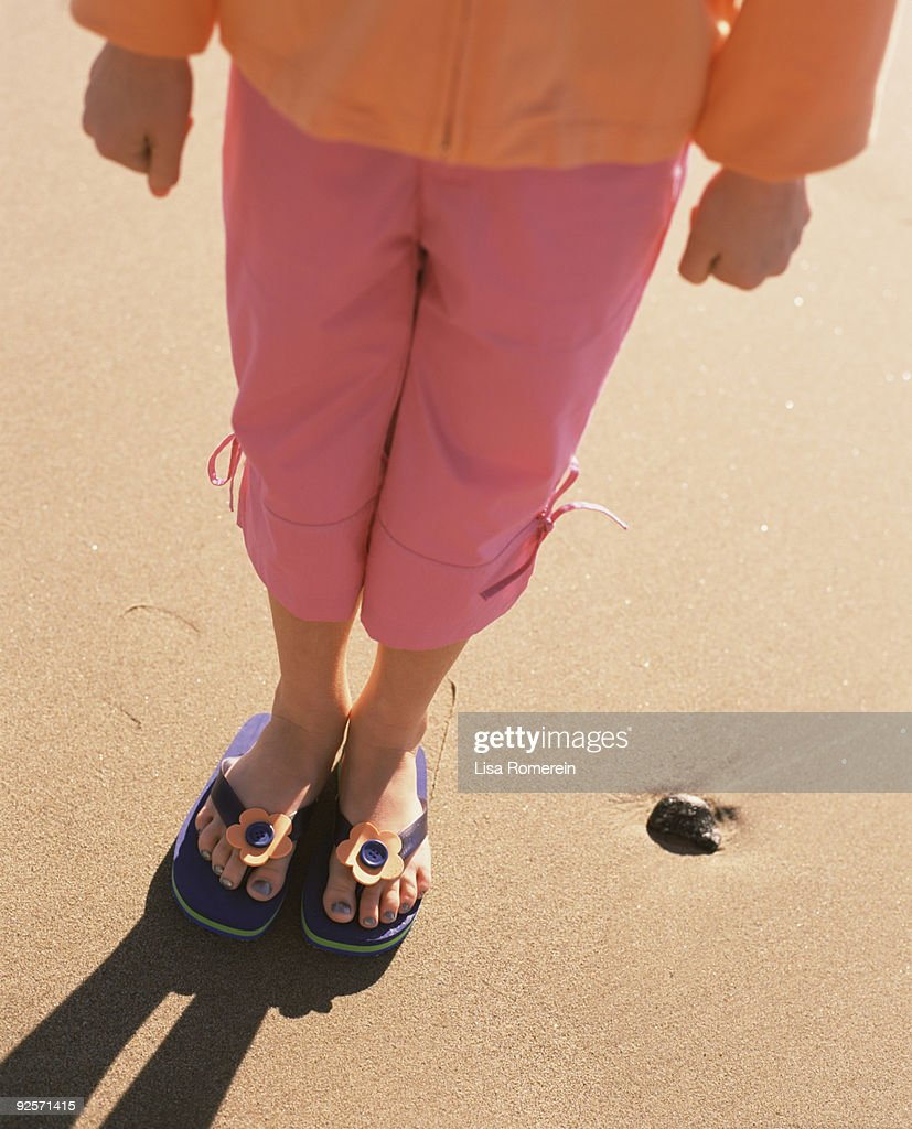 7d97eb51f803 Girl wearing flip-flops   Stock Photo