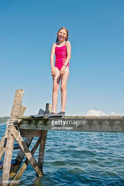 girl wearing flippers on jetty