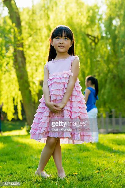Girl wearing frilly pink dress