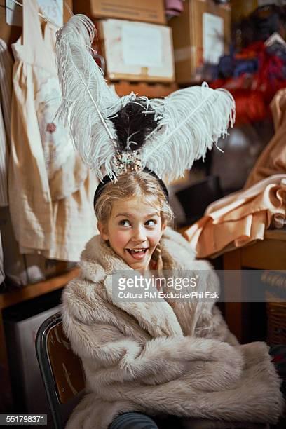 Girl wearing fur coat theatre costume backstage
