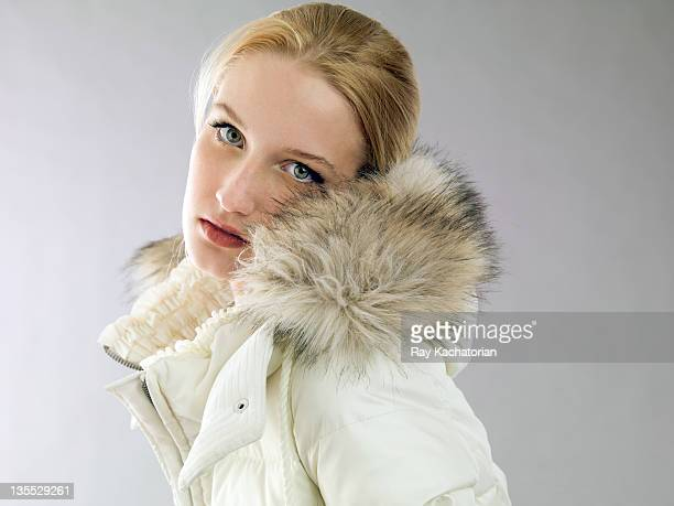 girl wearing fur hooded coat - collar stock photos and pictures