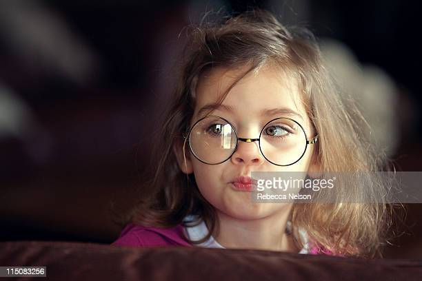 Girl wearing glasses with pursed lips