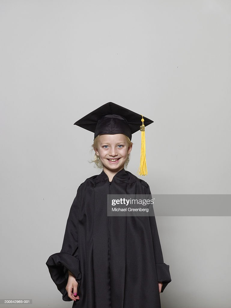 Girl Wearing Graduation Cap And Gown Portrait Stock Photo | Getty Images